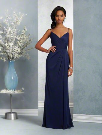 A long, beautiful bridesmaid gown with a sweetheart neckline, spaghetti straps, and fluted skirt.